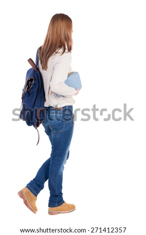 Girl with a backpack on his back is a stack of books. back view. Rear view people collection.  backside view of person.  Isolated over white background.