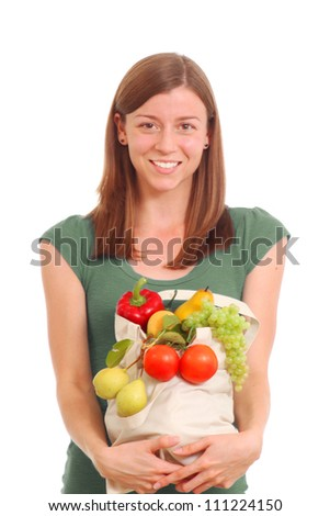 Girl with a bag of healthy foods