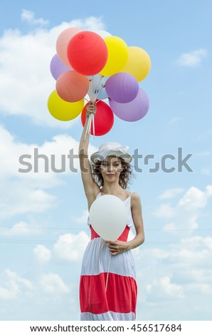 girl with a balloon flying in the clouds