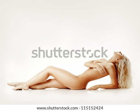 girl with a beautiful figure and splendid hair - stock photo