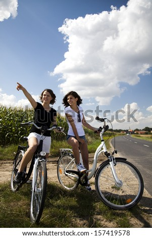 Girl with a bicycle enjoying
