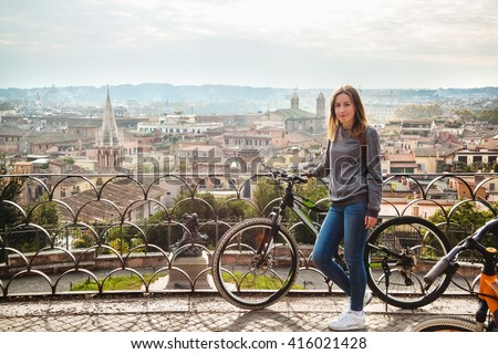 Girl with a bicycle in Rome, Italy - stock photo