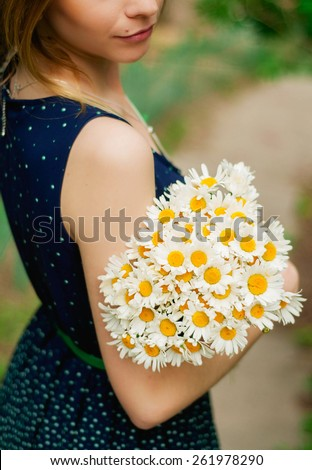 girl with a bouquet of chamomiles - stock photo