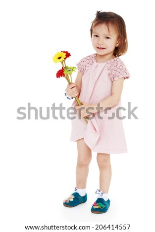 Girl with a bouquet of flowers on a white background.happy childhood, carefree childhood concept.