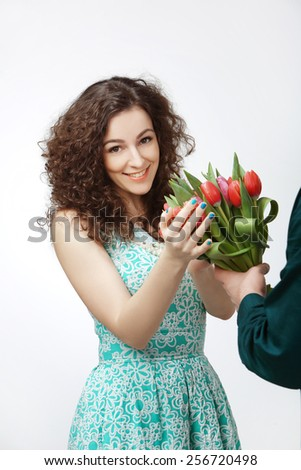Girl with a bouquet of pink tulips on a white background