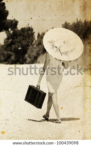 girl with a briefcase and a Japanese umbrella. Photo in old color image style. - stock photo