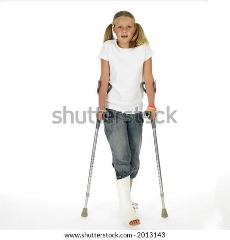 Girl with a broken leg walking on crutches - stock photo
