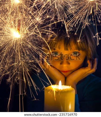 girl with a candle and sparkler - stock photo