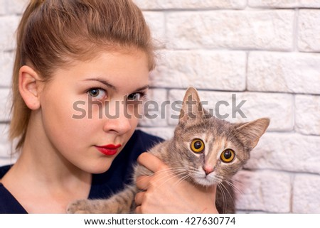 Girl with a cat - stock photo