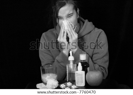 Girl with a cold blows her nose