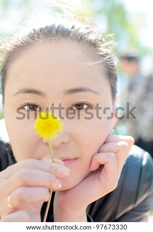 Girl with a dandelion - stock photo