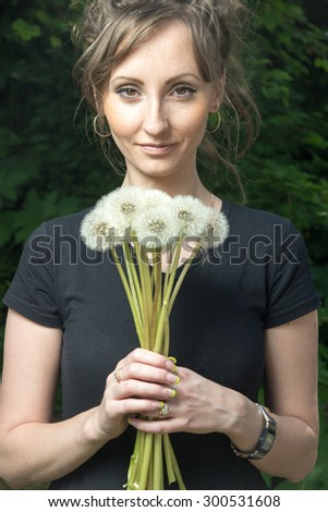 girl with a dandelion in his hand - stock photo