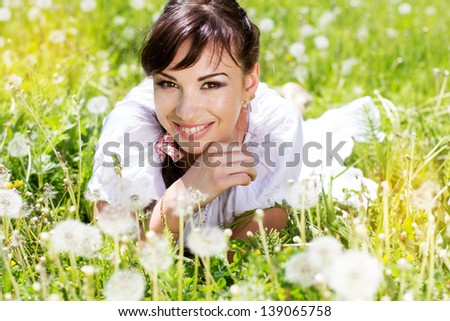 girl with a dandelions - stock photo
