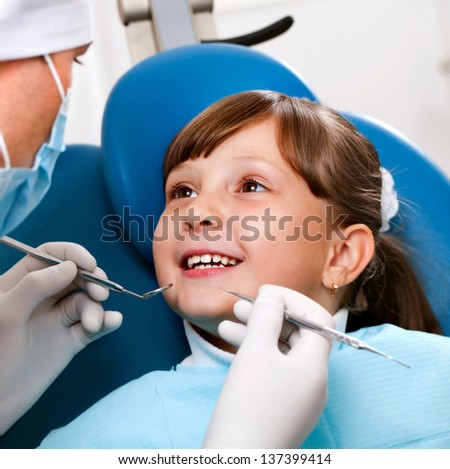 girl with a doctor in a dental office - stock photo