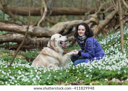 girl with a dog golden retriever in the colors of the forest,