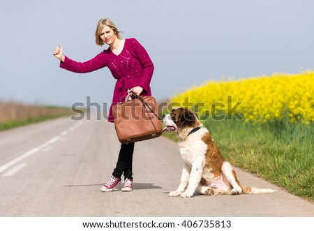 Girl with a dog hitchhike