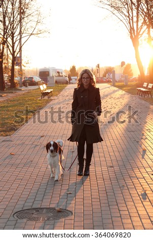 Girl with a dog on the street