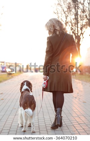 Girl with a dog on the street - stock photo