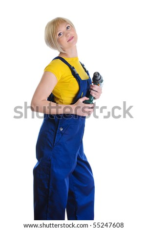 girl with a drill in building overalls. Isolated on white background