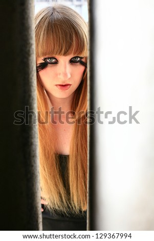 girl with a feather lashes in eyes, make up beauty portrait - stock photo
