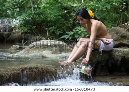 girl with a flower in her hair taking on water