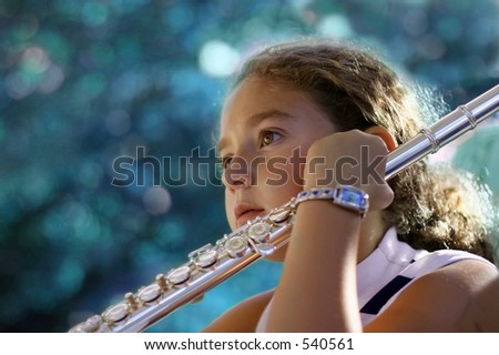 Girl with a flute - stock photo