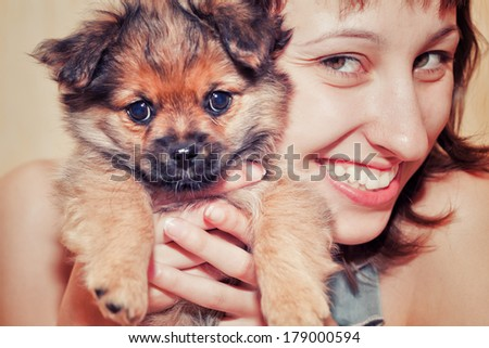 Girl with a funny dog - stock photo
