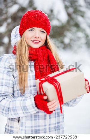 Girl with a gift in her hands