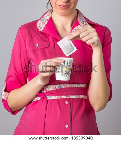 girl with a glass of hot water makes tea