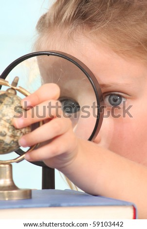 Girl with a globe - stock photo