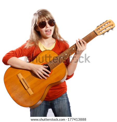 girl with a guitar singing on a white background - stock photo