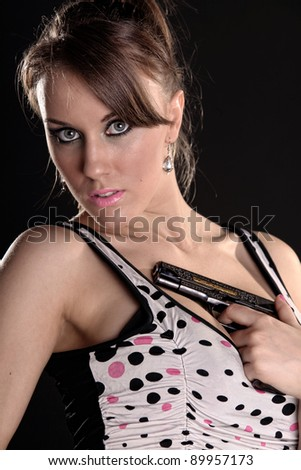 girl with a gun on a black background