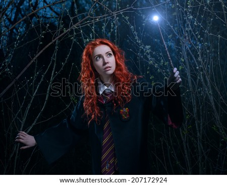Girl with a magic wand goes through the forest towards the demon