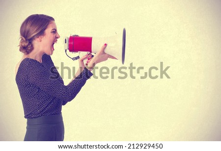 Girl with a megaphone - stock photo