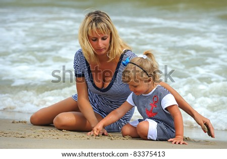 Girl with a mother at the seaside