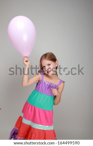 Girl with a pink air balloon on Holiday