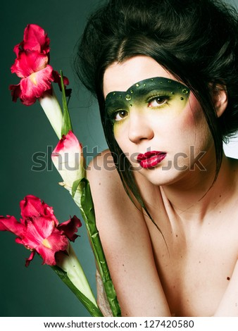 Girl with a pretty face and red flowers