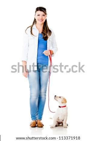 Girl with a puppy dog on a leash - isolated over a white background - stock photo
