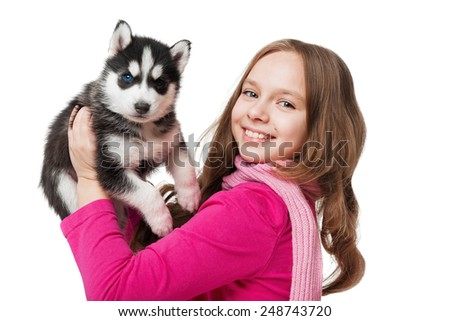 Girl with a puppy husky - stock photo