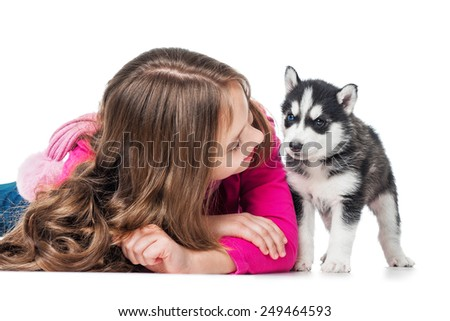 Girl with a puppy husky, isolated on white