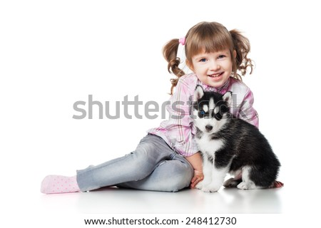 Girl with a puppy, isolated on white background - stock photo