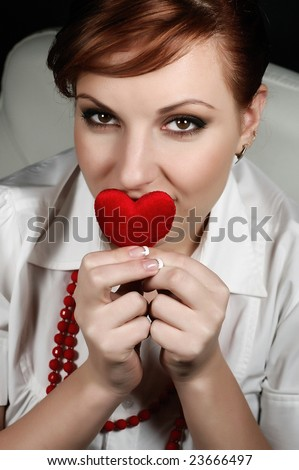 girl with a red heart in hands