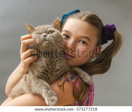 Girl with a scottish cat - stock photo