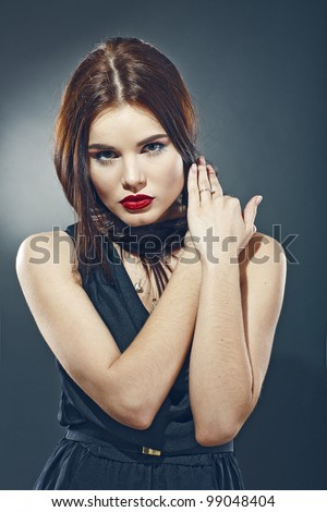 Girl with a sensual eyes in black dress - stock photo