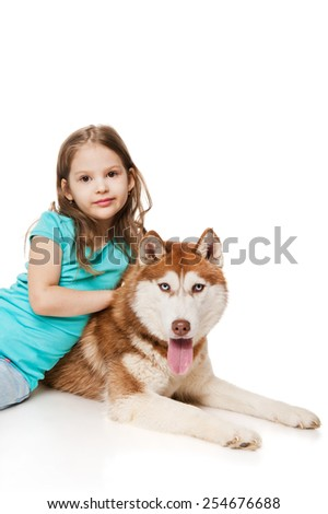 Girl with a siberian husky - stock photo