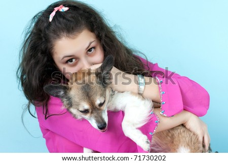 girl with a small dog in hands