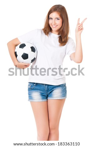 Girl with a soccer ball, isolated on white background - stock photo