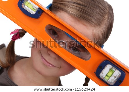 Girl with a spirit level - stock photo