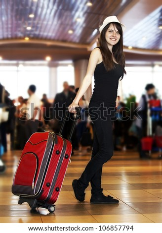 girl with a suitcase at the airport, at the station. - stock photo