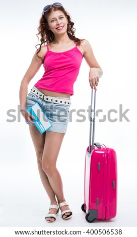 Girl with a suitcase going traveling on white background - stock photo